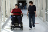 MJM237  Tommy Urbanski (cq) walks with his wife, Kathy Urbanski (cq) after completing a session of...