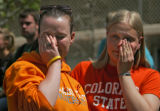Shelby Wood (cq), left, 22, and Erica Holtzman (cq), 20, riight, wipe away tears at a memorial for...