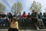 Ellen Cooney (cq), bottom left, of the University Counseling Center, sits in prayer with CSU...