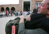 (at right) Cary Kohout (cq) gets a hug from Brandy Eileen Arlitt (cq) on the evening of Wednesday,...