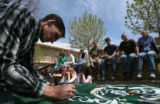Grad student Nathan Brandt (cq), 30, signs a CSU banner for Virginia Tech at a memorial for...