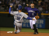 DLM0634  Colorado Rockies' Troy Tulowitzki makes the throw to first to get Los Angeles' Rafael...