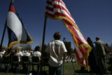 Dillon Whited (cq), 11, a fifth grader at Slavens K-8 school, stands behind dignitaries attending...