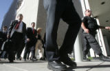 Federal police officers escort former Qwest CEO Joe Nacchio from federal court to a downtown...