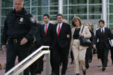 Former Qwest CEO Joe Nacchio, with his family and attorneys, leaves federal court after being...