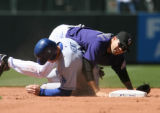 Rockies second baseman, Jamey Carroll, forces out Dodgers Jeff Kent, at second base in the top of...