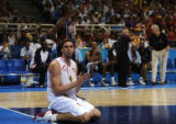 Spain's Pau Gasol, #4, pleads with a referee after being called for a foul near the end of the...