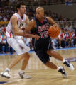 United States guard Stephon Marbury, #15, drives past Spain's Rodolfo Fernandez, #13, during the...