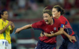 (ATHENS, GREECE- AUGUST 26,2004) United States' #16, Abby Wambach, center, and #11, Julie Foudy,...