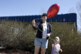 Gail Loeffler (cq) and her daughter Brianna Loeffler, 4, released thirteen balloons in the free...