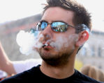 CU student Devin Withelow (cq),22, enjoys a smoke as thousands of people showed up to smoke pot on...