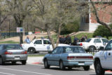 Police were present in force outside the high school. Ten marked cars were counted at noon. East...