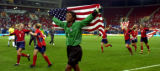 (ATHENS, GREECE- AUGUST 26,2004) United States goalie Briana Scurry and the team race around the...
