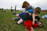 DLM1107  Laura Reed laughs as her daughters Jessica, 4, and Sarah, 8, pile on top of her after...