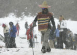"Stephen ""Beamer "" Boehmer walks to his skis  at Loveland Sunday May 6, 2007. He chose to..."