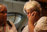 Mary An Rupp (cq), the wife of Martin Rupp, a former Rocky Flats employee, weeps after the Board...