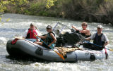 (L-R) Nicole Bianchi,Lana Uhlman, Jason Uhlman and Mark Bergdolt steer their 13 1/2 foot raft to...
