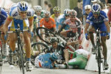 LUC108 - Some riders of the cycling pack fall on the asphalt during the sprint before they cross...