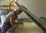 Jackie Chang (cq) fills a cup with Queso De Mano cheese from a bulk tank, Monday afternoon, April...