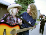 Photo by Dean-- Volunteer extraordinaire Donna Herod comforts Judy Hagan, one of Delta's colorful...
