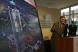 Mayor John Hickenlooper points to a artist rendition of the new Four Seasons Hotel, Tuesday...