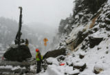 MJM076 Brian Genoua, left, an employee of Wenter drills holes in a 50 ton boulder in order to...