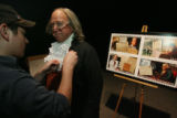 Sean Weinert, (cq), of Event Services, removes the microphone from Mr. Franklin as they both stand...
