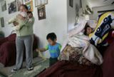 0219 Marleny Navaro, CQ, 30, left, of Guatemala, holds her daughter Adelpha, 2mo. while her...