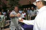 Steffan Tubbs, (cq) returned a baseball to Colorado Rockies shortstop Troy Tulowitzki at a press...