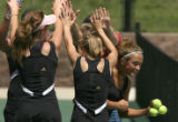 Ponderosa High tennis players create a tunnel for teammate Morgan Forsyth, to pass through after...