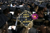 "Sarah Kessler (cq), 23, a fine arts major, decorated her graduation cap with ""It only took..."
