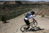 Shane Spencer (cq), of Littleton, rides on the Ruistler's Loop above the Colorado River near...