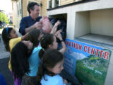 Matt Hogan (cq) helps a second grade class from Good Shepard Catholic School donate clothes at the...