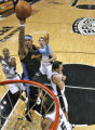 Denver Nuggets forward Carmelo Anthony rises above San Antonio Spurs defenders in the fourth...