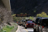 Traffic east bound on I-70 come to a stop before the Hanging Lake tunnel, Friday afternoon, April...
