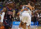 American basketball player Allen Iverson, left, dribbles the ball off the courts whil...