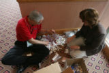 Bob Gates and Leslie Mohr, (cq both), sit n sort...The rule is 10 mints per bag as they prepare...