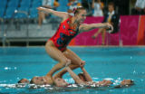 (ATHENS, GREECE-AUGUST 27, 2004)  A member of the United States Synchronised Swim Team is carried...