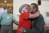 BJ Abernethy (cq) gives 78 year-old Don Scheuer (cq), a hug and a kiss, as he is retiring as...