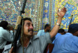 NYT15 -  (NYT15) NAJAF, Iraq -- Aug. 27, 2004 -- IRAQ-NAJAF-14 -- Iraqi police become emotional as...