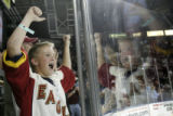 Dillion Lund, 14, of Loveland, cheers as the Colorado Eagles defeat the Memphis River Kings 5-3 in...