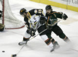 Greg Pankewicz, left, is defended by Louis Dumont during the 2nd period of the Colorado Eagles...