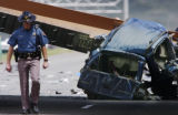 (LAKEWOOD, Colo., May 15, 2004) -- A Colorado State Patrol trooper walks away from a sports...