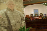 CPL Dale Spiehs, a member of his fallen comrad stands guard over Cpl. Wade Oglesby Friday Apr...