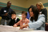 Consultant Renee Martinez-Stone, cq, right, of Perspective 3, points out proposed plans during a...