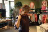 Marla Bell (cq), does some shopping in Pine Creek Clothing,   Monday morning, April 30, 2007, at...