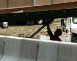 (LAKEWOOD, Colo., May 15, 2004) -- An unidentified workman examines a girder that a sports utility...