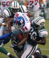 ERU101 - New York Giantswide receiver Tim Carter fumbles the ball as he is hit by New York Jets'...