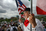 DLM0654  Pedro Rodriguez, 52, holds both an American and a Mexican flag as he listens to the...