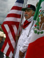 DLM0723  Pedro Rodriguez, 52, holds both an American and a Mexican flag as he listens to the...